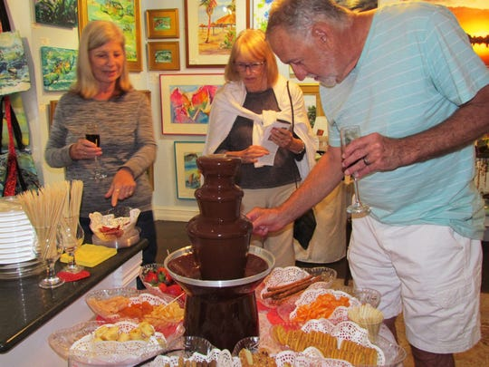 The chocolate fountain with a variety of dipping tidbits was the hit of the Friday open house.