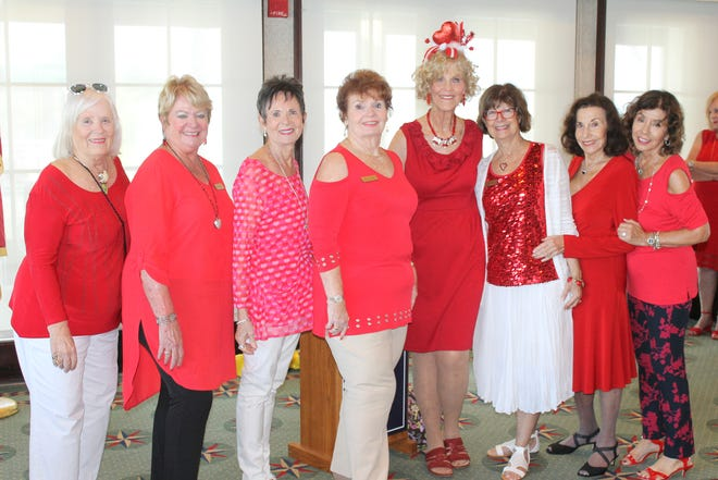 Lovely in red are Jo Bailey, Pat Hagedorn, Pat Matthews, Trisha Pease, Susie Walsh, JoAnn Brandau, Jean King and Marge Superits.