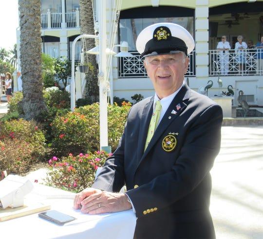 MIYC Commodore Ray Rosenberg readies to begin the program.