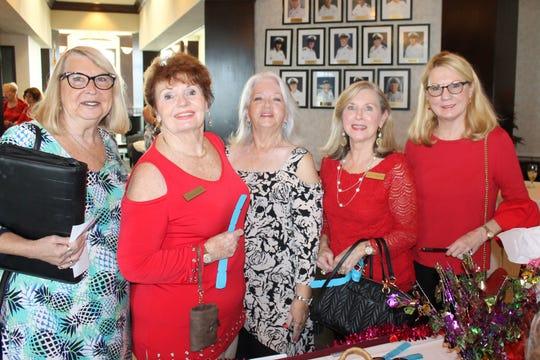 Rachel DeHanas, Trisha Pease, Jacky Childress, Janet Dickens and Charlene Winter wait to buy 50/50 tickets.