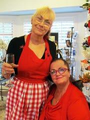 Artists Bonnie Hauke and Malenda Trick prepare for the February Open House.