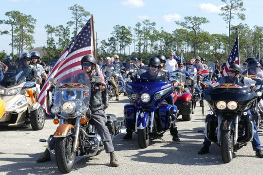 Hundreds of bikers at the I-75 rest stop by exit 131 get ready to escort The Wall That Heals from Fort Myers to Marco Island on Feb. 18, 2020.