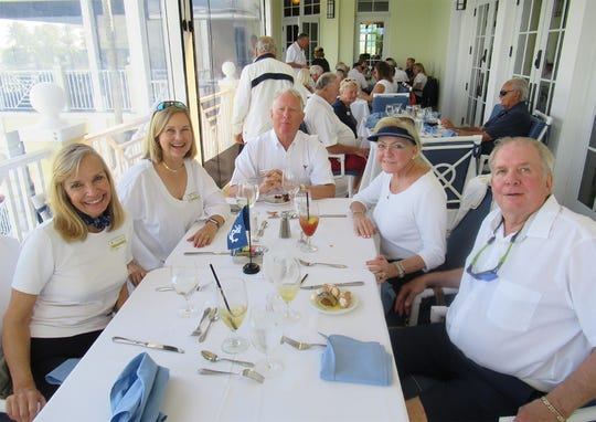 Following the Blessing and Fleet review, members enjoyed a buffet luncheon on the veranda. Above, from left, are Ginny Colangelo, Carol Comeaux, Jeff Comeaux, Judy Hamilton and Craig Seelman.