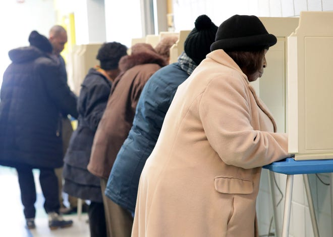 People vote at the Mary Ryan Boys & Girls Club of Greater Milwaukee on North Sherman Boulevard in Milwaukee on Tuesday.