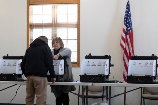 A man is assisted by an election worker in the Town of Fulton. Voters in the town were testing a voting system that uses software made by Microsoft that allows voters to verify that their ballot was counted. Because this is a test, local election officials will be hand counting all paper ballots voters cast to verify the winners.