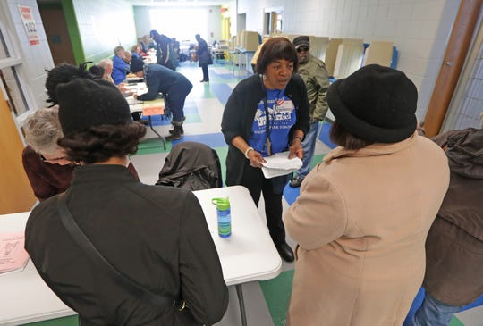 Chief inspector Deborah Ford-Lewis, second right, assists voters at the Mary Ryan Boys and Girls Club of Greater Milwaukee on North Sherman Boulevard in Milwaukee.  Voters across Wisconsin headed to the polls to cast ballots in a variety of state and local spring primary races to narrow the field of candidates ahead of the April 7 general election.