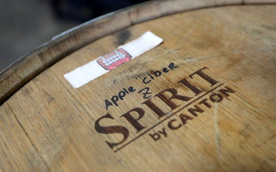 A barrel is stamped with a customer's label in the warehouse at John Gill's company, The Barrel Broker in Menomonee Falls.