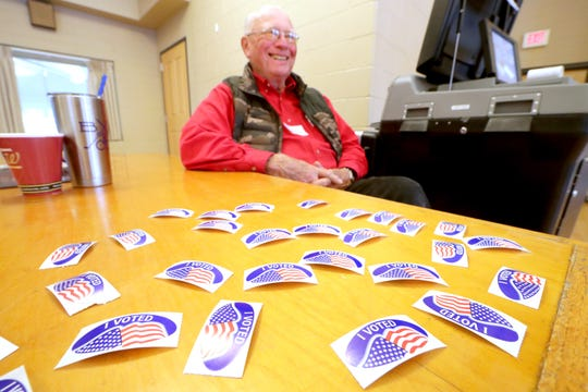 Poll worker Bill Martens mans the ballot machine and I Voted stickers at the Hart ParkMuellnerBuilding in Wauwatosa.