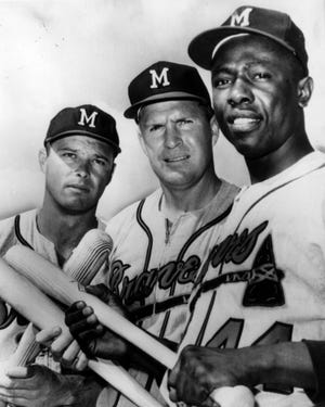 From left: Eddie Mathews, Del Crandall and Henry Aaron brought some heavy lumber to the formidable lineup of the Milwaukee Braves.