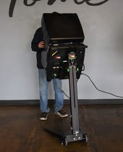 A voter uses one of Baxter County's new voting machines Tuesday at the Twin Lakes Plaza voting center.