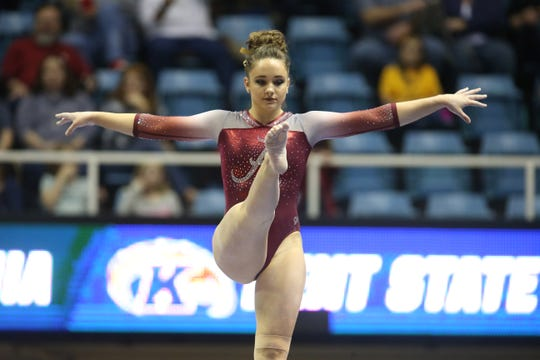 Apr 1, 2017; Morgantown, WV, USA;  University of Alabama gymnast Wynter Childers (105) competes on the balance beam at the NCAA Regional Championships at the WVU Coliseum. Mandatory Credit: Charles LeClaire-USA TODAY Sports
