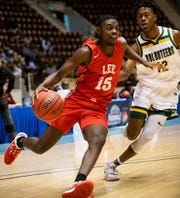 Lee's De'Marquiese Miles (15) drives again st Jeff Davis' Jakendric Reeves (12) in AHSAA regional basketball action in Montgomery, Ala., on Tuesday February 18, 2020.