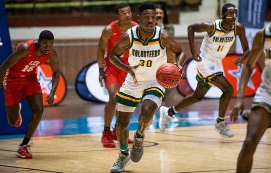 Jeff Davis' Rongie Gordon (30) drives against Lee in AHSAA regional basketball action in Montgomery, Ala., on Tuesday February 18, 2020.