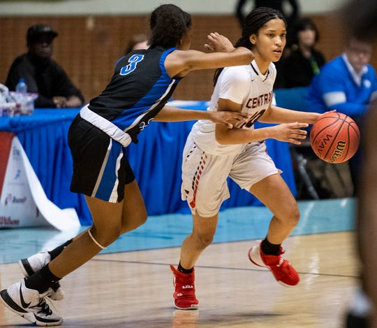 Central-Phenix City's Sierra Roberts drives against Auburn's Syriah Daniels in AHSAA regional basketball action in Montgomery, Ala., on Tuesday February 18, 2020.