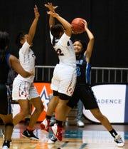 Central-Phenix City's Mya Richardson and Alleya King (22) double team Auburn's Brianna Harris in AHSAA regional basketball action in Montgomery, Ala., on Tuesday February 18, 2020.