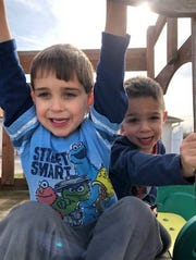 From left to right: Twins Cincaid and Cutter both spent more than 50 days in IU Health Ball Memorial Hospital's NICU. Now, their interests include superheroes.
