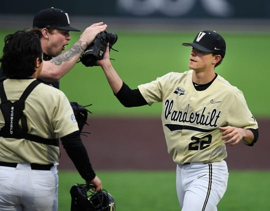 Vanderbilt pitcher Tyler Brown and catcher CJ Rodriguez, left, congratulate freshman pitcher Jack Leiter (22) after he strike out all three South Alabama batters during the first inning at Hawkins Field Feb. 18, 2020.