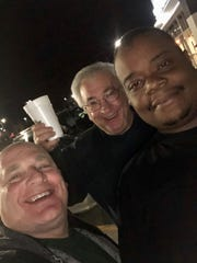 Brad Schmitt, left, with friends Phil Covington, right, and Preston O'Neal