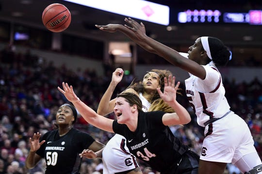 Vanderbilt forward Mariella Fasoula (34) is fouled attempting a shot against South Carolina forward Laeticia Amihere, right, and Mikiah Herbert Harrigan, left, during the first half on Monday, Feb. 17, 2020, in Columbia, S.C.