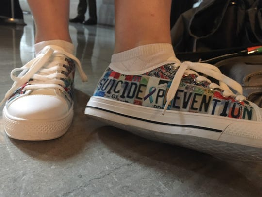 Kim Ward, from Jamestown, wore her special suicide prevention shoes to the legislature on Feb. 12, 2020.