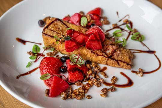 Crispy fried brie with vinegared berries, candied pecans and aged balsamic syrup at Ellington's in The Fairlane Hotel.