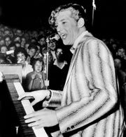 """Jerry Lee Lewis bellows there's a """"Whole Lot of Shakin' Goin' On"""" during the Record Hop show at the Tennessee State Fairgrounds Coliseum on Jan 18, 1958."""