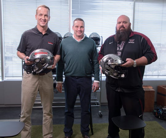 Riddell CEO Dan Arment (center) stands with former NFL quarterback Peyton Manning (left) and Peoria (Ill.) High football coach Tim Thornton at Riddell's headquarters in April 2019. Arment will be honored at the Collier County Chapter of the National Football Foundation's annual scholarship banquet Sunday, Feb. 23.