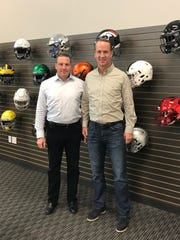 Riddell CEO Dan Arment (left), pictured with Peyton Manning, strategic advisor and brand ambassador for Riddell at the company's production facility in North Ridgeville, Ohio. Arment will be honored at the Collier County Chapter of the National Football Foundation's annual scholarship banquet Sunday, Feb. 23.