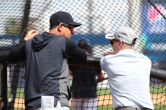 Feb 18, 2020; Tampa, Florida, USA; New York Yankees manager Aarnon Boone (17) talks with general manager Brain Cashman during spring training at George M. Steinbrenner Field.