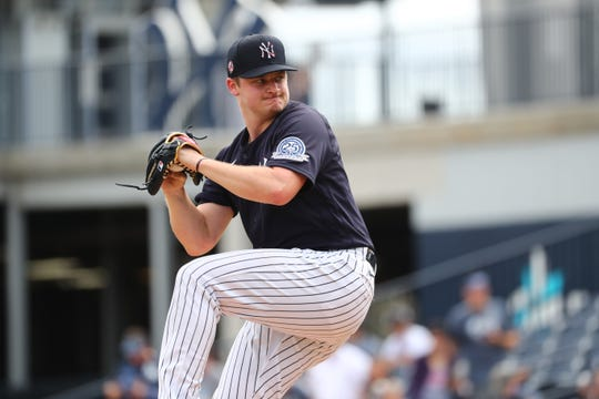Feb 16, 2020; Tampa, Florida, USA; New York Yankees pitcher Clarke Schmidt (86) pitches during a live batting practice at spring training at George M. Steinbrenner Field.