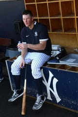 Feb 18, 2020; Tampa, Florida, USA;New York Yankees first baseman DJ LeMahieu (26) takes a break from the heat as he works out during spring training at George M. Steinbrenner Field.