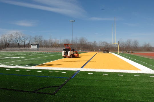 The artificial turf field installation in West Milford is nearly complete in this March 17, 2011 photo.