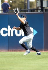 Feb 18, 2020; Tampa, Florida, USA; New York Yankees outfielder Giancarlo Stanton (27) works out during spring training at George M. Steinbrenner Field.