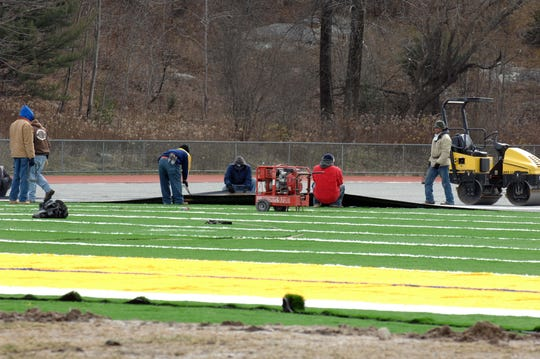 The synthetic field at West Milford High School's varsity field is seen undergoing installation on Dec. 9, 2010.