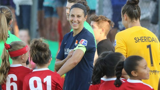 US WomenÕs World Cup player Carli Lloyd with some junior players as she returns as captain of Sky Blue before the start of the game against Washington on July 24, 2019 in Piscataway, NJ.