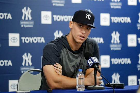 New York Yankees' Aaron Judge pauses while speaking at a news conferece after a spring training baseball workout Tuesday, Feb. 18, 2020, in Tampa, Fla.
