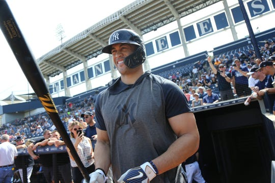 Feb 18, 2020; Tampa, Florida, USA; New York Yankees designated hitter Giancarlo Stanton (27) walks out to batting practice as he works out during spring training at George M. Steinbrenner Field.