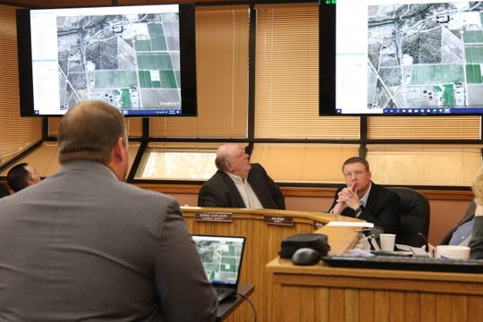 From left: Eddy County Public Works Director Jason Burns, Eddy County Commission Chairperson Ernie Carlson and District 2 County Commissioner Jon Henry look at picture of a proposed road vacation during a Feb. 18, 2020 meeting in Carlsbad.
