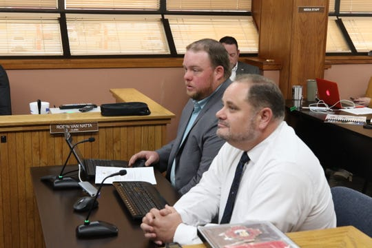 Eddy County Public Works Director Jason Burns (left) and Eddy County Freeholders Board Member John Waters get ready to discuss road vacations in Eddy County on Feb. 18, 2020.