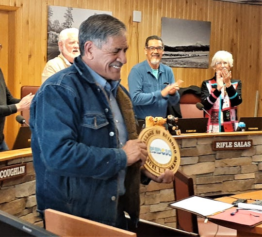 Ruidoso village councilors applaud as Manuel Medrano, Solid Waste Service Maintenance Technician, accepts recognition as he retired after 17 years of service.