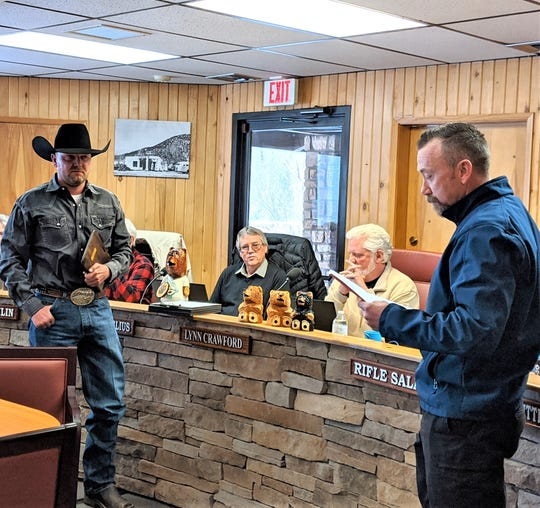 Cody Wilson- Assistant Fire Chief. at left. listens as Ruidoso Fire Chief Cody Thetford thanks him for his 20 years of service and wishes him well on his  retirement.