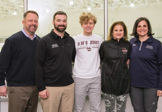 Pictured, from left, are Ira Place, Eric Schwab, Conor Place, Nikki Place and Christina Eyers, Henry Ford's director of athletic training and community outreach.