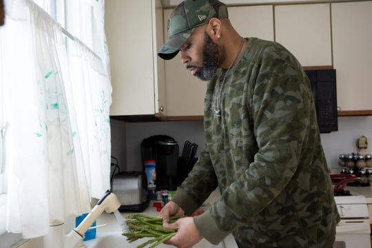 Darryl Filban bariatric surgery patient, at home preparing a healthy meal.