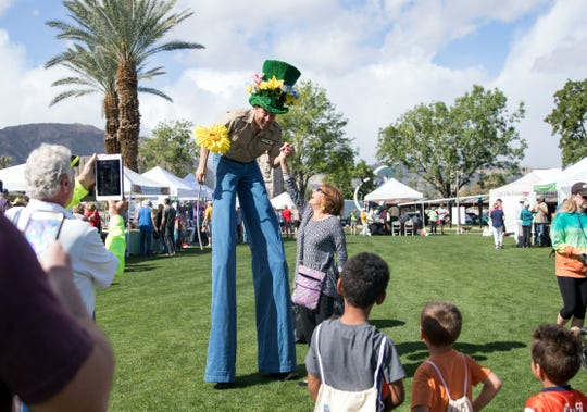 A previous Wildflower Festival included a stilt walker adorned in flowers.