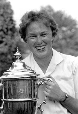 FILE - In this July 1, 1961 file photo, Mickey Wright poses after winning her third Women's National Open golf championship, at the Baltusrol Golf Club at Springfield, N.J. Hall of Fame golfer Wright, who won 82 LPGA tournaments including 13 majors, died Monday, Feb. 17, 2020, of a heart attack, her attorney said. Wright was 85.