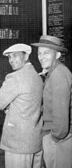 Among the celebrities at Tamarisk Country Club in the 1950s were Ben Hogan, left, the club's head pro in the early days, and entertainer Bing Crosby.