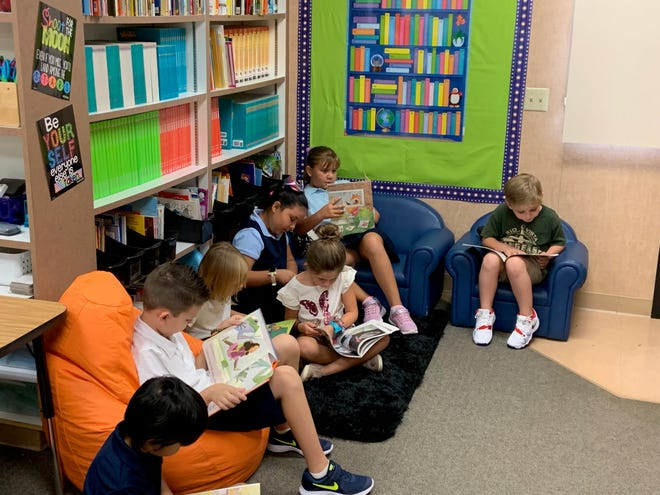 """Second graders in Kathleen Yearwood's classroom participate in """"Lefty's Reading Challenge."""""""