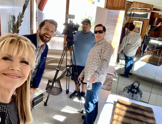 Sandie Newton, Danny Heller and Kip Serafin smile for a selfie as Edward Luna, NBC Palm Springs' chief photographer, sets up.