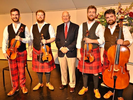 Chris Seidel, president of Palm Springs Concerts, smiles with Maxwell Quartet musicians Elliot Perks, Colin Scobie, George Smith and Duncan Strachan.