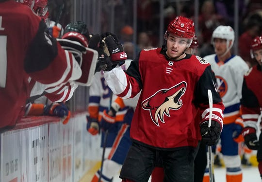 Arizona Coyotes right wing Clayton Keller (9) celebrates with teammates after scoring a goal against the New York Islanders in the first period during an NHL hockey game, Monday, Feb. 17, 2020, in Glendale, Ariz. (AP Photo/Rick Scuteri)